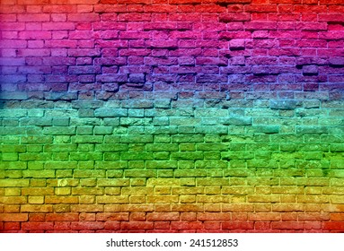 Concept or conceptual colorful painted or graffiti old vintage grungy brick wall texture or urban background, metaphor to art, city, street, artistic, creative, culture, retro, underground brickwall