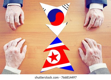 Concept of confrontation between North Korea and South Korea. Diplomacy and hard talks