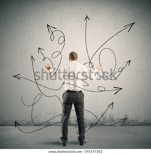 Concept of confused choice of a businessman with arrows