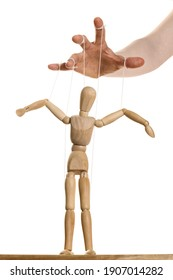 Concept of control. Marionette in human hand.