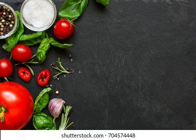 concept cook work with vegetables, spices and herbs on dark background. top view with copy space. mock up