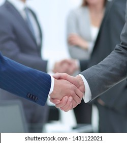 concept of cooperation.handshake of business partners