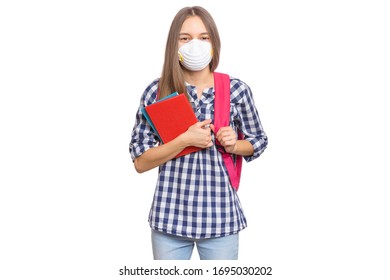 Concept of coronavirus quarantine. Child wearing medical protective face mask to health protection from influenza virus. COVID-19. Student teen Girl with bag and books, isolated on white background.
