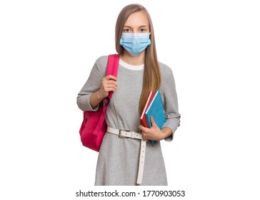 Concept of coronavirus quarantine. Child wearing medical protective face mask to health protection from influenza virus. COVID-19. Portrait of Student teen Girl with bag and books, isolated on white.