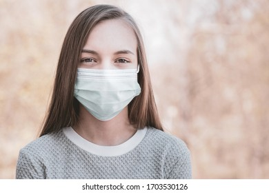 Concept of coronavirus quarantine. Girl wearing medical mask to health protection from influenza virus. Outdoor portrait of child in protective face mask. COVID-19, self isolation. Prevention epidemic