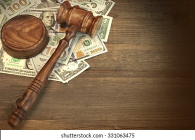 Concept For Corruption, Bankruptcy Court, Bail, Crime, Bribing, Fraud, Auction Bidding. Judges or Auctioneer Gavel, Soundboard And Bundle Of Dollar Cash On The Rough Wooden Textured Table Background.