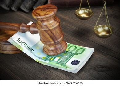 Concept For Corruption, Bankruptcy Court, Bail, Crime, Bribing, Fraud.  Judges or Auctioneer Gavel And Bundle Of Euro Cash On The Rough Wooden Table. Top View