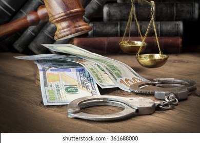 Concept For Corruption, Bankruptcy Court, Bail, Crime, Bribing, Fraud, Judges Gavel, Soundboard And Bundle Of Dollar Cash On The Rough Wooden Textured Table Background.