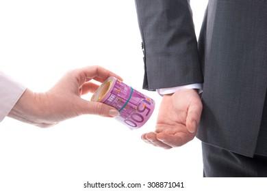Concept corruption. Businessman in a suit takes a bribe