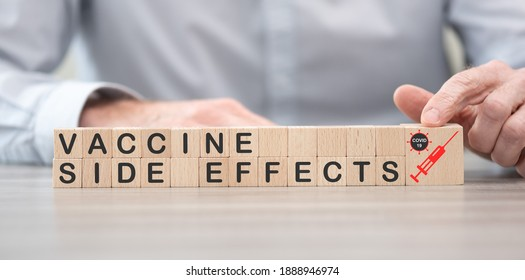 Concept of Covid-19 vaccine side effects on wooden cubes