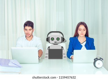 Concept of coworking young man and woman with innovative robot sitting at table in office. Customer service representative and robotics concept. Human vs robot at workplace.