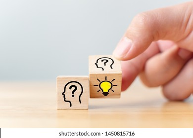 Concept creative idea and innovation. Hand flip over wooden cube block with head human symbol and light bulb icon