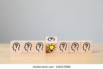 Concept creative idea and innovation. Wooden cube block flip over with head human symbol and light bulb icon
