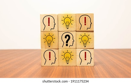 Concept creative idea and innovation. Wooden cube block flip over with head human symbol and light bulb icon.