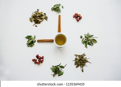A concept or creative idea that means tea time. Useful herbal or green tea in the center and around the various dried herbs for its preparation