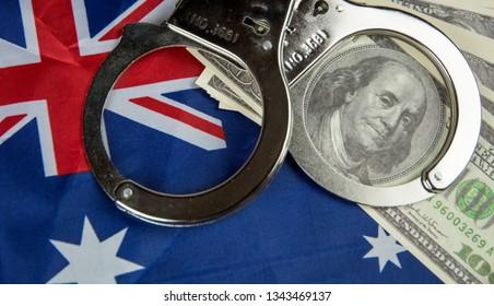 Concept crime in Australia. Dollars, handcuffs and australian flag
