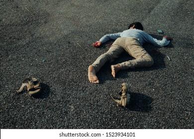 Concept of Crime scene , victim dead body lying on Road.