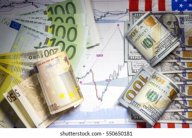 Concept of currency trading. Hundred us dollar bills lying . Fan shaped euro hundred banknotes. Currency us euro rate chart under the bills. Rolled euro bills and  us dollar bills. US  flag.