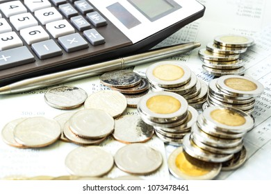 Concept of currency trading, making a decision for an optimal gain. Graph and rows of coins for finance and business concept.