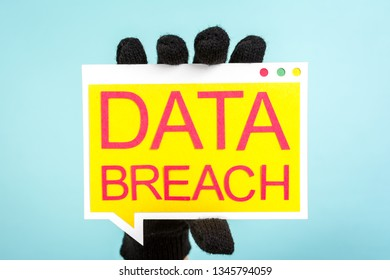 """Concept of data breach, security, confidential and cybercrime. Hand with gloves showing a speech bubble with the words """"DATA BREACH""""."""
