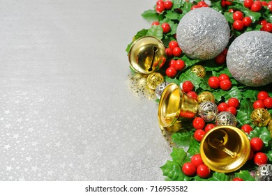 The concept of decorations in the Christmas Eve.Holy fruit and golden bells on Silver background.