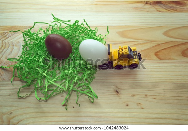 concept of delivering eggs on Easter with toy loader