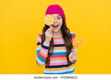 concept of dental health. sweet tooth. yummy. happy teen girl hold lollipop. lollipop lady. hipster kid with colorful lollypop sugar candy on stick. caramel candy shop. sweet childhood life.