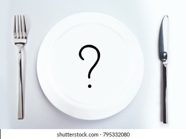 Concept of a diet. Healthy Eating. Empty plate with a question mark on the table.