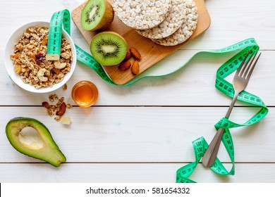 Concept diet - healthy food with muesli, honey, kiwi and cereals - Shutterstock ID 581654332