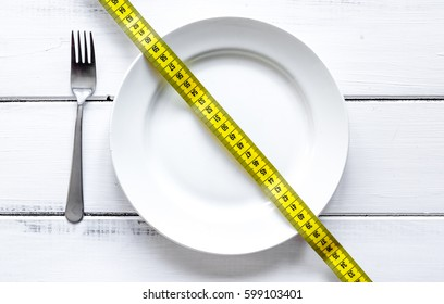 concept diet and weight loss on wooden background top view