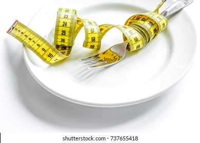 concept diet and weight loss on white background top view