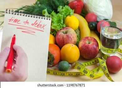 Concept of diet, word time to detox written in a notebook. Vegetables and fruits: Aavakado, figs, feijoa, cleansing the body, healthy eating.