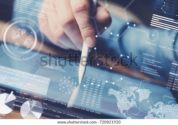 Concept of digital diagram,graph interfaces,virtual display,connections icon.Man using contemporary electronic tablet at office.Blurred background. Horizontal