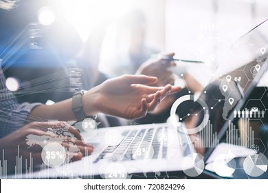 Concept of digital diagram,graph interfaces,virtual screen,connections icon on blurred background. Business meeting process.Female hand pointing to laptop computer display.Horizontal
