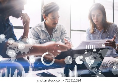 Concept of digital diagram,graph interfaces,virtual screen,connections icon on blurred background.Presentation new business project.Group of young coworkers discussing ideas in modern office