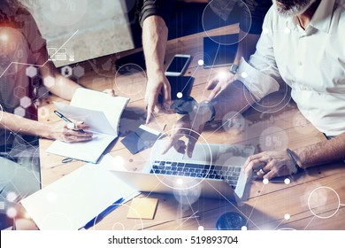 Concept of digital screen,virtual connection icon,diagram,graph interfaces.Male hands pointing to screen modern laptop.Teamwork process in coworking office.Horizontal