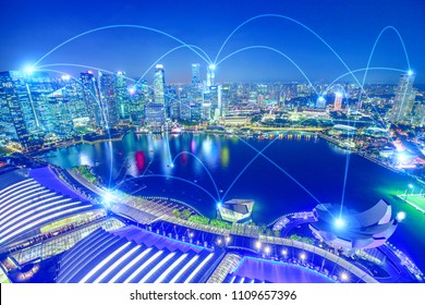 The concept of digital wifi connection and virtual connectivity in 5G between companies of a city. The financial district of Singapore skyline with sky background in blue with connection lines.