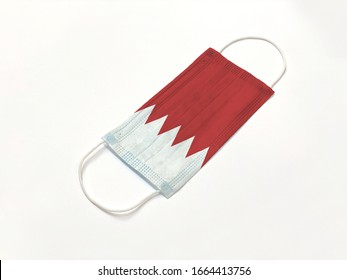 Concept. Disposable medical surgical face mask with Singapore country flag superimposed on it, on white background. Protection against Covid-19 coronavirus outbreak.