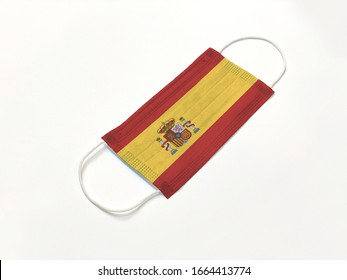 Concept. Disposable medical surgical face mask with Spain country flag superimposed on it, on white background. Protection against Covid-19 coronavirus outbreak.