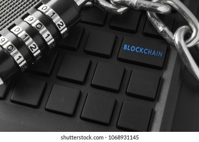 Concept of distribution network technology blockchain. Lock, chain keyboard. characters on remote keys Blockchain enter key