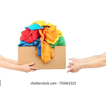 The concept of donating. Hands are giving a box of clothes to other hands on a white background.
