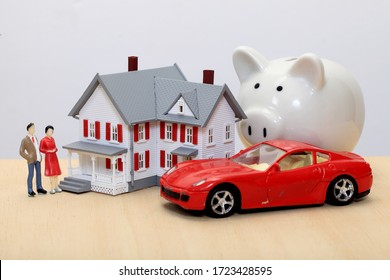 Concept of dream house-Model house and piggy bank close up