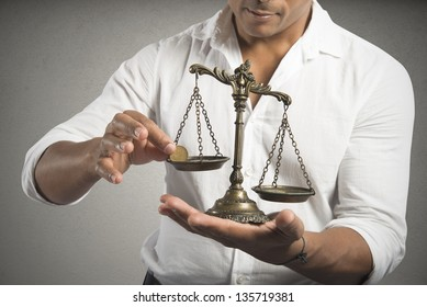 Concept of earning balance with businessman that weighs the money