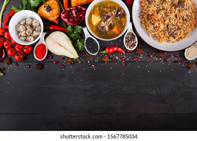The concept of Eastern asian festive cuisine. Assorted Uzbek food set, pilaf, samsa, lagman, manti, shurpa restaurant concept Eastern arabic new year and Christmas dish from lamb served cookware.
