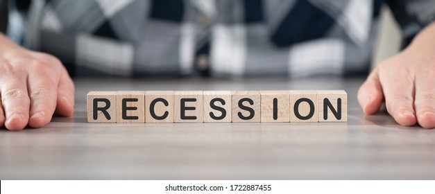 Concept of economic recession on wooden cubes