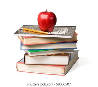 Concept of education. A red apple and pencil sitting on top of a stack of school books.
