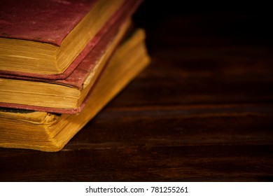 Concept of education, stack of old very worn books.