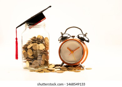 Concept for education where time is money. Coins in a glass jar and scattered around.