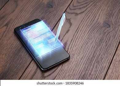 Concept of electronic signature, business at a distance, Image of a phone and a hologram of a contract and a pens for signature. Remote collaboration, online business, copy space. Mixed media