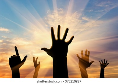 Concept of emotions and feelings. Silhouette of hands of people on the sunset background